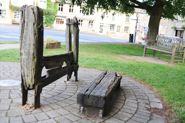 The penal stocks in Stow-on-the-Wold, Cotswolds